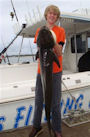 Cobia battled by this proud young man on a BKs Gold Coast fishing Charters on 07-07-2009